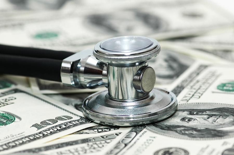 Stethoscope and dollars illustrating expensive healthcare