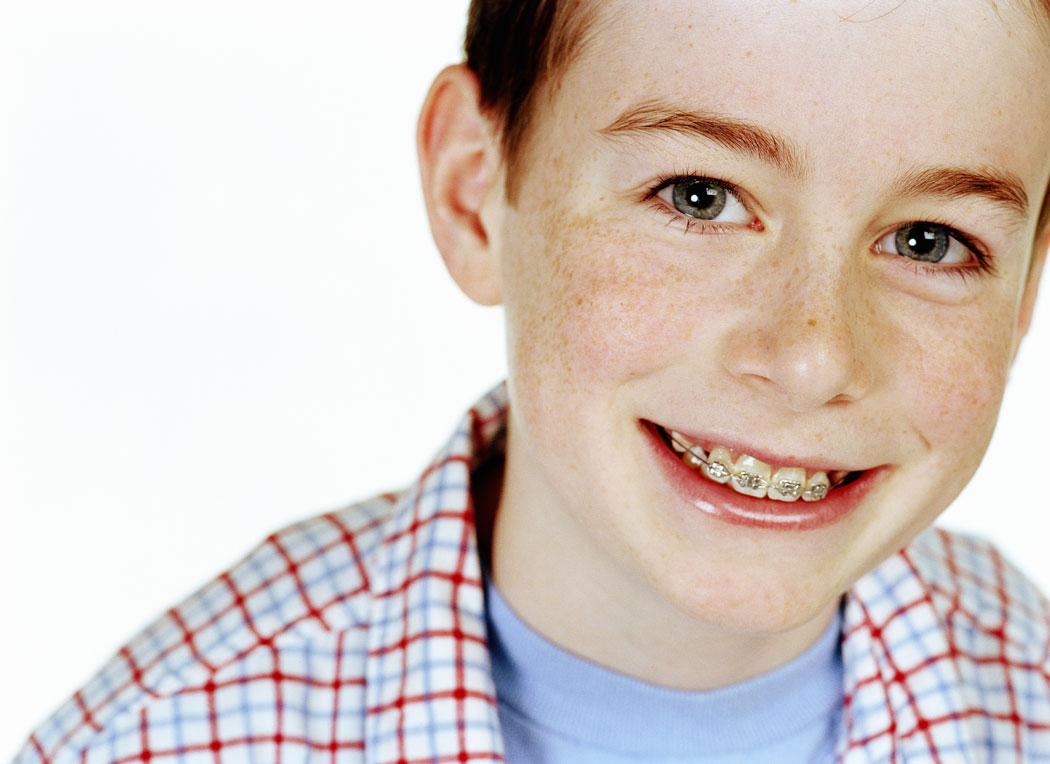 boy-with-braces-smiling