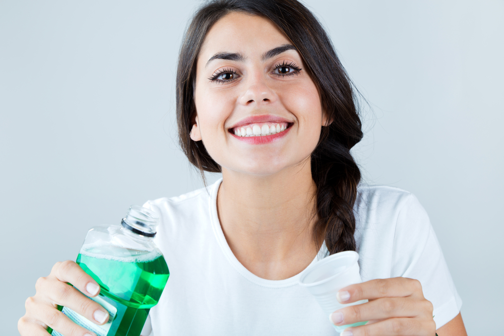 Woman-Mouthwash