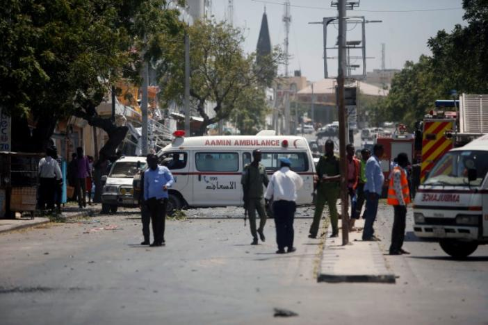Aamin ambulances arrive near the scene of a suicide car explosion in Maka Al Mukarama street of Mogadishu
